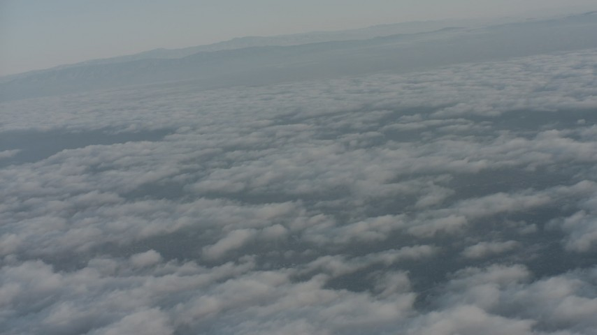 4K stock footage aerial video of clouds over Ventura County while approaching mountain ridges, California Aerial Stock Footage | WA001_012