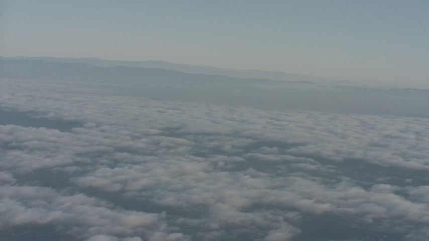 4K stock footage aerial video pan across clouds and mountain ridges in Ventura County, California Aerial Stock Footage WA001_013 | Axiom Images