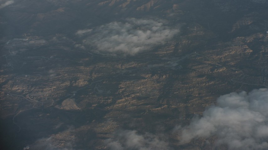 4K stock footage aerial video of a bird's eye view of clouds over mountains and suburbs in Santa Clarita Valley, California Aerial Stock Footage   WA001_016