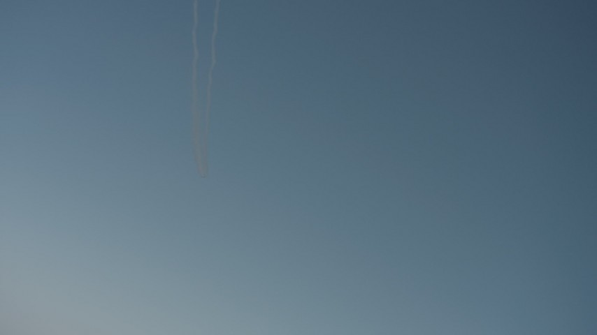 Air-to-air view of jet contrails overhead in Solano County, California Aerial Stock Footage | WA001_032
