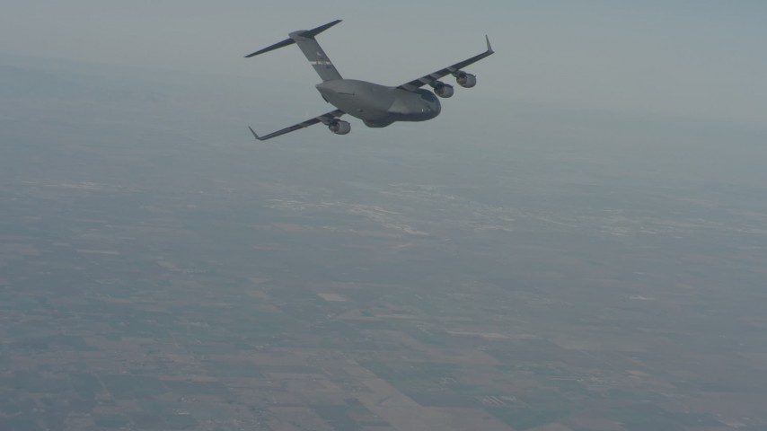 4K stock footage aerial video of a Boeing C-17 in flight over Solano County, California Aerial Stock Footage | WA001_033