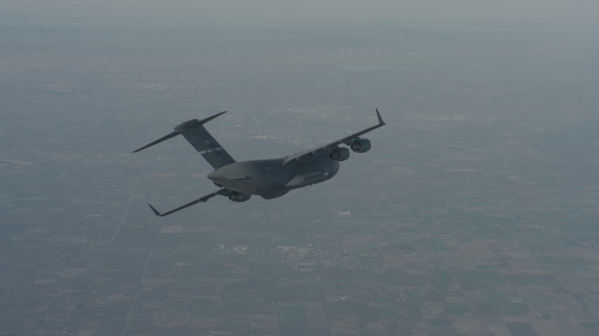 4K stock footage aerial video track a Boeing C-17 in flight over Solano County, California Aerial Stock Footage | WA001_034