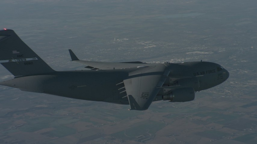 Flying beside a Boeing C-17 over Solano County, California Aerial Stock Footage WA001_035 | Axiom Images