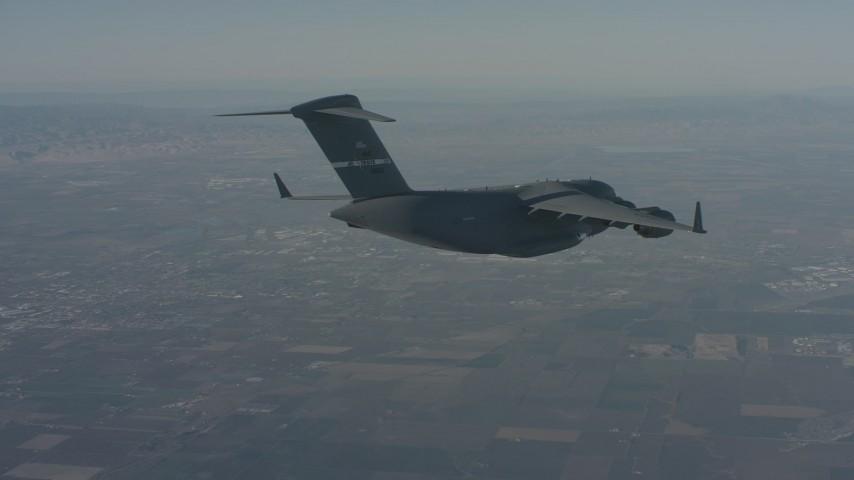 4K stock footage aerial video track a Boeing C-17 as it flies ahead over Solano County, California Aerial Stock Footage | WA001_041