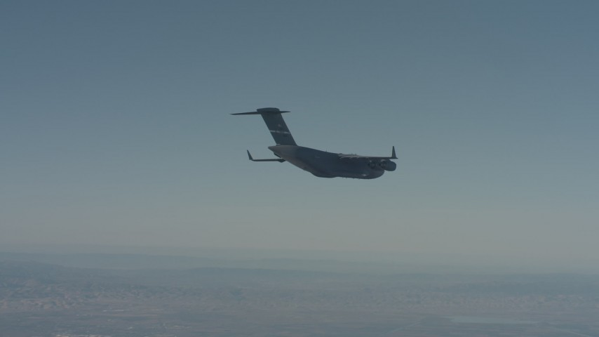4K stock footage aerial video of a Boeing C-17 flying over Solano County, California Aerial Stock Footage | WA001_042