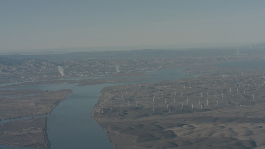 4K stock footage aerial video air-to-air view of a jet flying over Sacramento River and windmills, Solano County, California Aerial Stock Footage | WA001_048