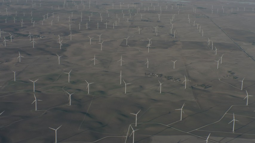 4K stock footage aerial video flyby a field of windmills in Solano County, California Aerial Stock Footage | WA001_051