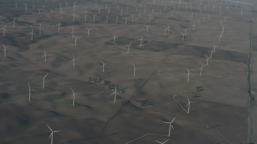 4K stock footage aerial video of passing a field of windmills in Solano County, California Aerial Stock Footage | WA001_052