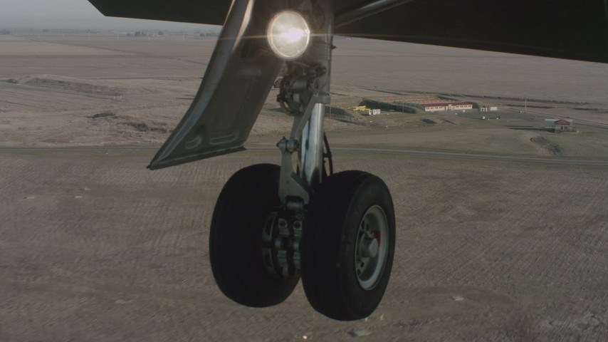 4K stock footage aerial video of a view of the Lear jet landing gear as it lands at Travis Air Force Base, California Aerial Stock Footage   WA001_056