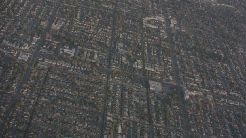 A bird's eye view of suburban neighborhoods in Canoga Park, California Aerial Stock Footage WA002_003 | Axiom Images
