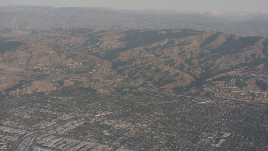4K stock footage aerial video fly over suburban homes to approach Highway 118 and the mountains, Chatsworth, California Aerial Stock Footage | WA002_004