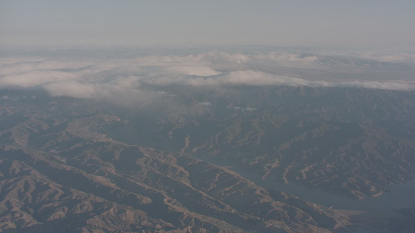 4K stock footage aerial video approach clouds near Castaic Lake in the Sierra Pelona Mountains, California Aerial Stock Footage | WA002_008