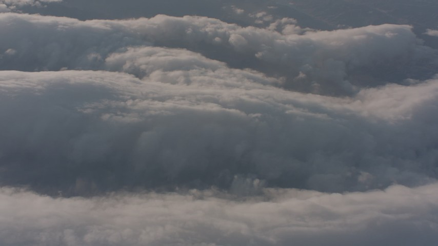 A reverse view of cloud layer above the Central Valley, California Aerial Stock Footage WA002_016 | Axiom Images
