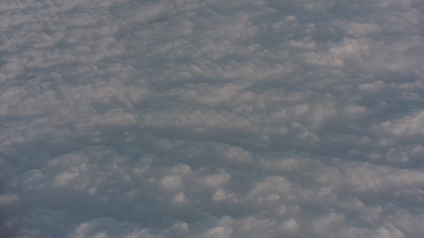 Tilt to a layer of clouds over the Central Valley, California Aerial Stock Footage WA002_019 | Axiom Images