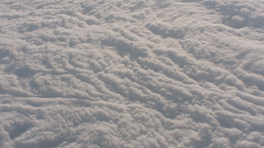 4K stock footage aerial video tilt to a bird's eye view of clouds over the Central Valley, California Aerial Stock Footage | WA002_021