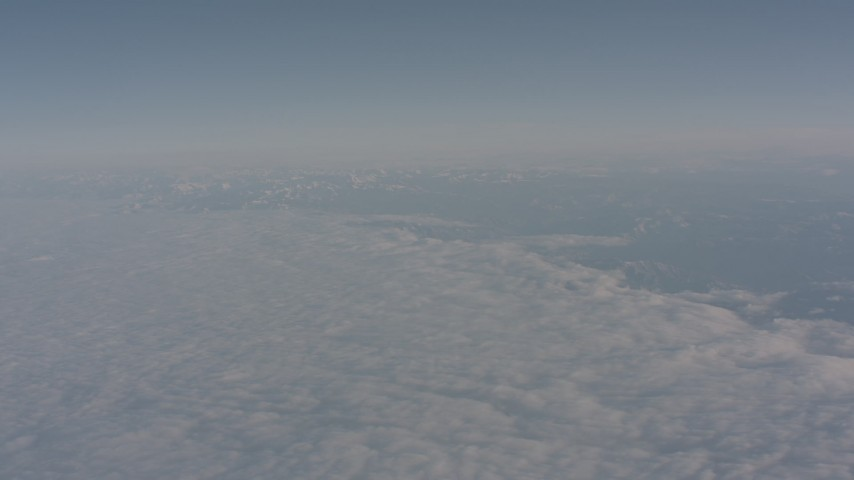 4K stock footage aerial video of the edge of a layer of clouds over the Central Valley, California Aerial Stock Footage   WA002_023