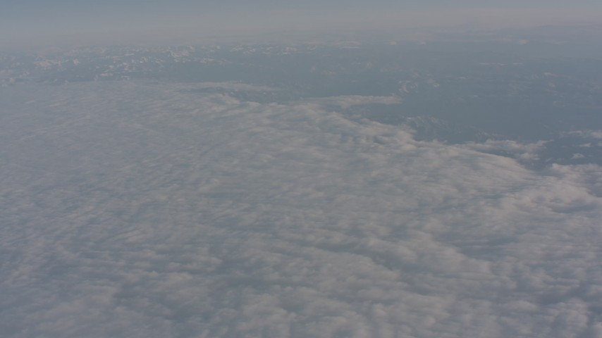 4K stock footage aerial video tilt to the edge of a dense layer of clouds over Central Valley, California Aerial Stock Footage WA002_024 | Axiom Images