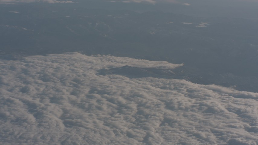 The edge of the cloud layer over the Central Valley, California  Aerial Stock Footage | WA002_030