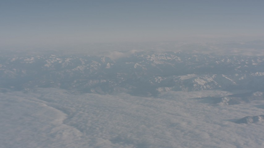 4K stock footage aerial video of clouds around snowy Sierra Nevada Mountains, California Aerial Stock Footage | WA002_032