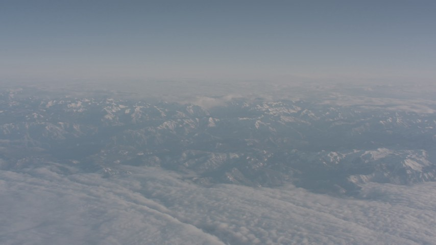 4K stock footage aerial video of a layer of clouds around the Sierra Nevada Mountains, California Aerial Stock Footage | WA002_035