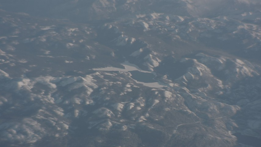 4K stock footage aerial video of an icy lake in the Sierra Nevada Mountains, California Aerial Stock Footage | WA002_042