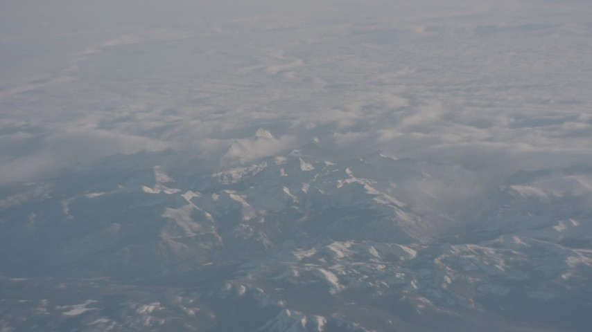4K stock footage aerial video of a layer of clouds behind the Sierra Nevada Mountains, California Aerial Stock Footage | WA002_043