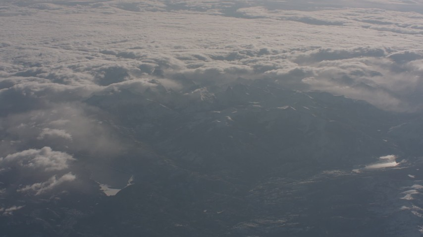 4K stock footage aerial video of the Sierra Nevada Mountains and clouds rolling over them, California Aerial Stock Footage | WA002_049