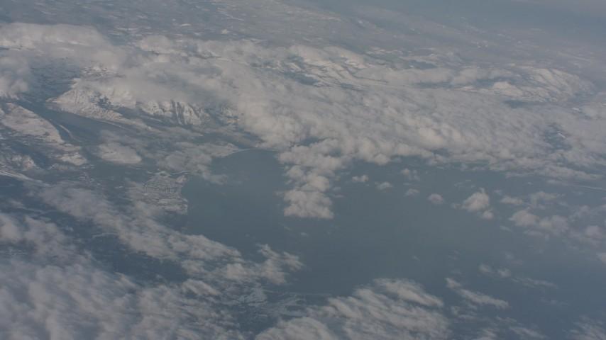 Pan across clouds surrounding Lake Tahoe, California Aerial Stock Footage | WA002_068