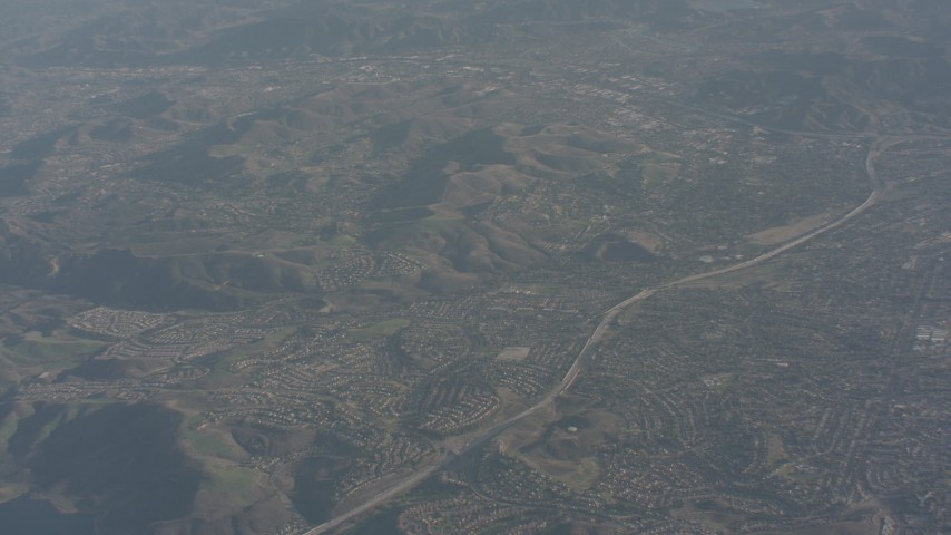 Freeway and suburban homes in Simi Valley, California Aerial Stock Footage | WA003_005