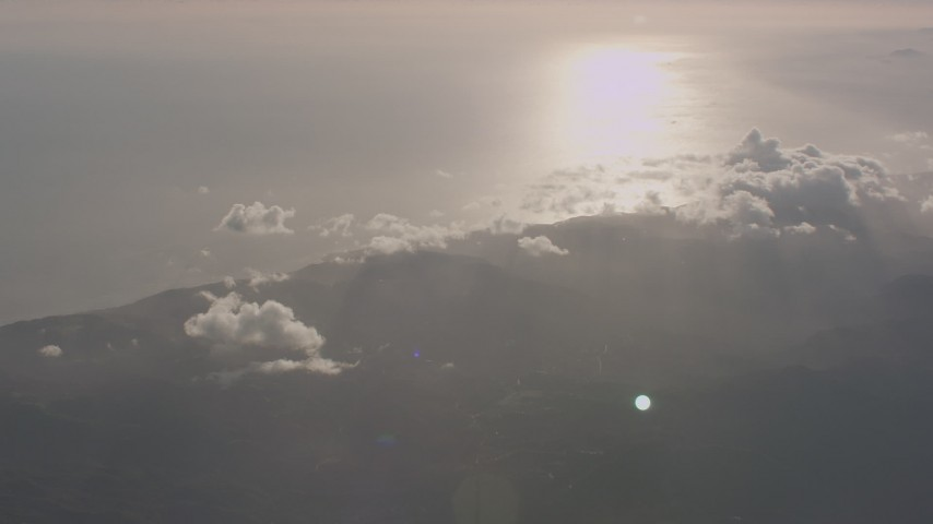 4K stock footage aerial video of the Santa Monica Mountains on the coast and sun reflection on the Pacific Ocean, California Aerial Stock Footage | WA003_011