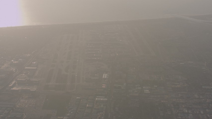 4K stock footage aerial video zoom closer to the runways at LAX (Los Angeles International Airport) in California Aerial Stock Footage | WA003_021
