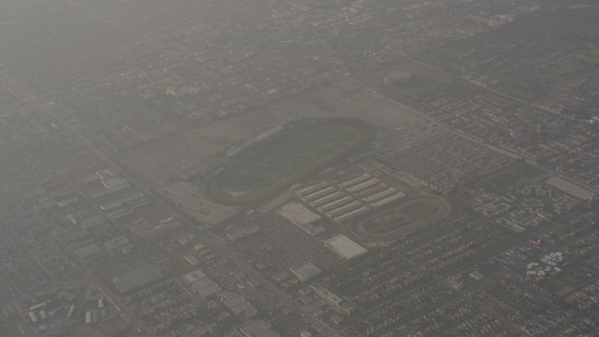 A reverse view of race tracks in Inglewood, California Aerial Stock Footage WA003_022   Axiom Images