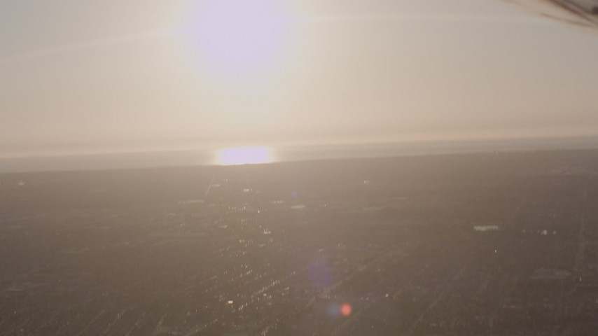 View across neighborhoods to the coast in the South Bay area of Los Angeles, California Aerial Stock Footage | WA003_025