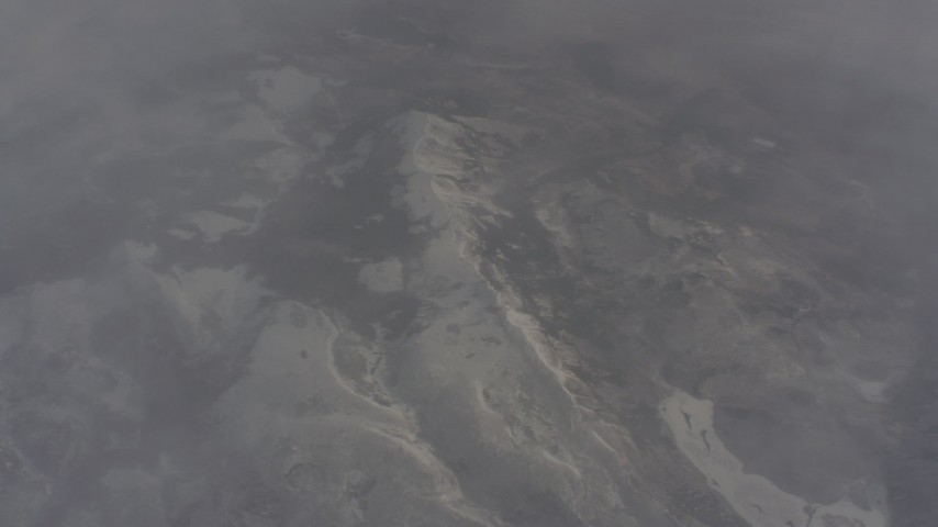 Bird's eye view of snowy mountain ridge and misty clouds in Lassen County, California Aerial Stock Footage | WA004_008