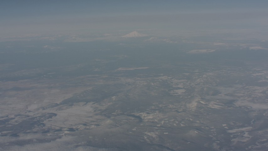 Tilt from snowy mountains to reveal Mount Shasta, Modoc County, California Aerial Stock Footage WA004_009 | Axiom Images
