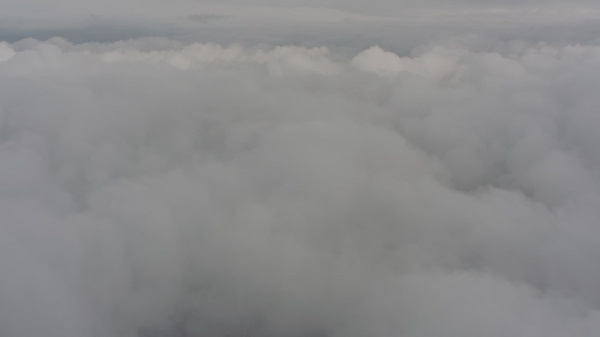 Fly over white clouds above Washington Aerial Stock Footage | WA004_035