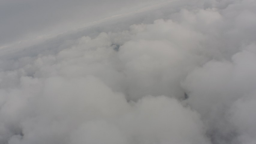 Flying above dense clouds over Washington Aerial Stock Footage WA004_036 | Axiom Images