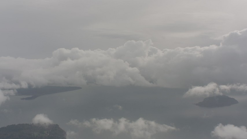 Passing clouds above Puget Sound, Washington Aerial Stock Footage | WA004_039