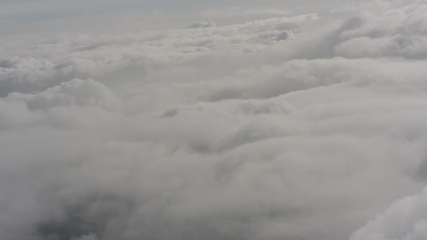 Fly over a cover of clouds in Washington Aerial Stock Footage | WA004_045