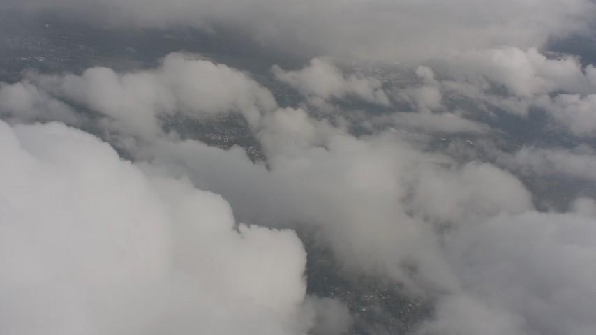 Flyby patchy clouds over suburban neighborhoods in Washington Aerial Stock Footage | WA004_047