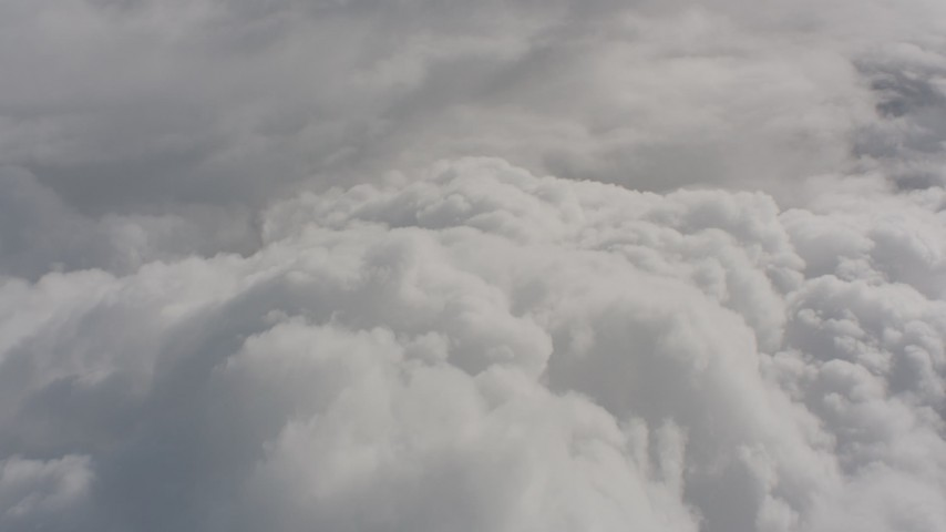 Fly over cloud cover above Washington Aerial Stock Footage | WA004_050