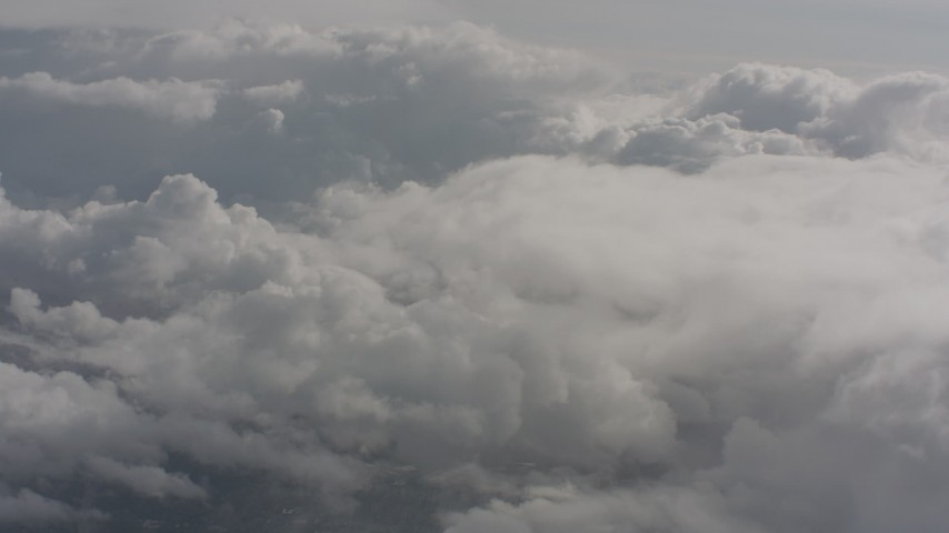 Fly through misty clouds toward more clouds over Washington Aerial Stock Footage | WA004_052