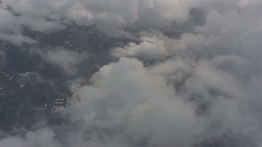 Bird's eye view of clouds over Snohomish County, Washington Aerial Stock Footage WA004_053 | Axiom Images