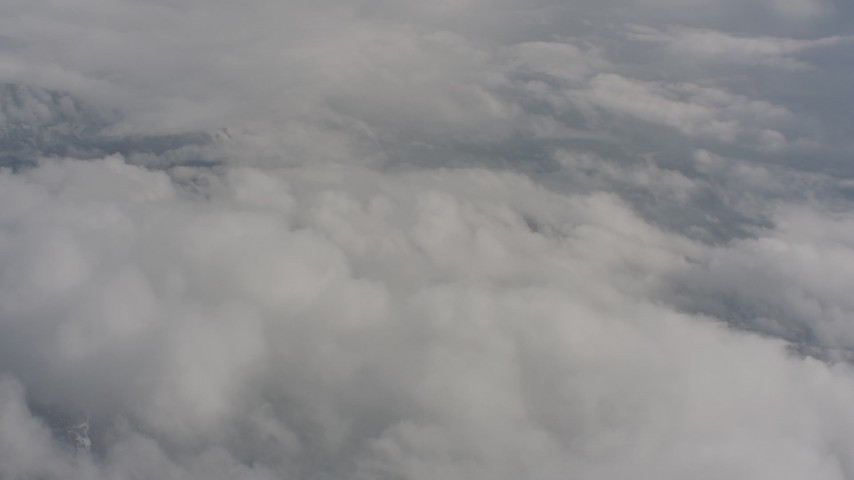 Fly over a cloud layer above Washington Aerial Stock Footage | WA004_065