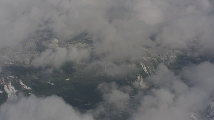 Fly over clouds and snowy mountains in Skamania County, Washington Aerial Stock Footage WA004_076 | Axiom Images