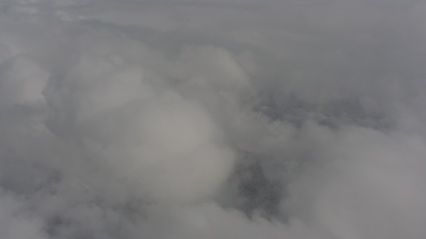 Flying by clouds over Skamania County, Washington Aerial Stock Footage | WA004_078
