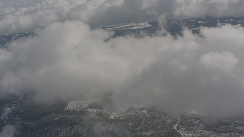 Approach clouds over snowy forests in Washington Aerial Stock Footage | WA004_087