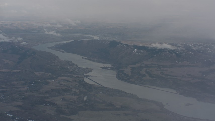 Approach the Columbia River and mountains between Washington and Oregon Aerial Stock Footage | WA004_096