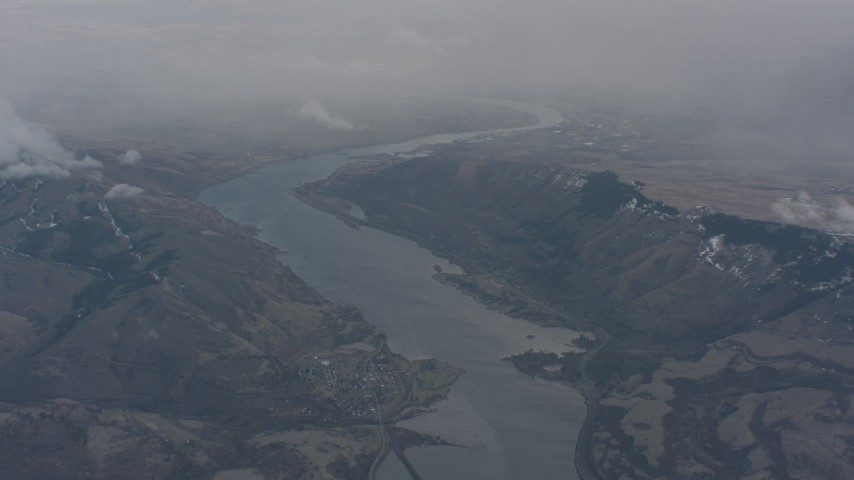 Following the Columbia River between mountains on the border of Washington and Oregon Aerial Stock Footage | WA004_097