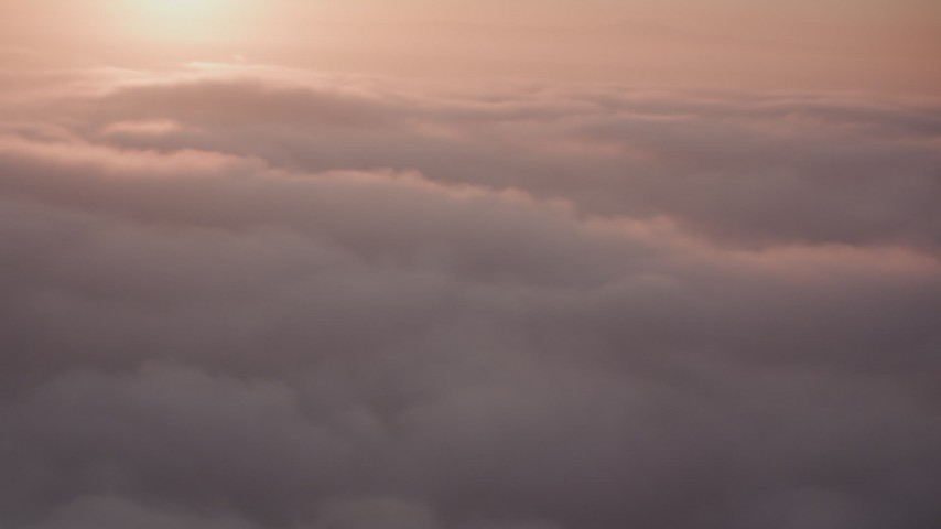 Flyby clouds above Southern California at sunset Aerial Stock Footage | WA005_003